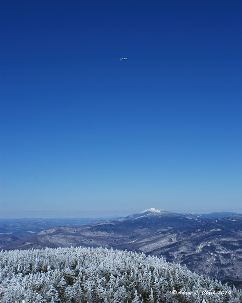 Just before putting the camera away, this plane flew past the mountain
