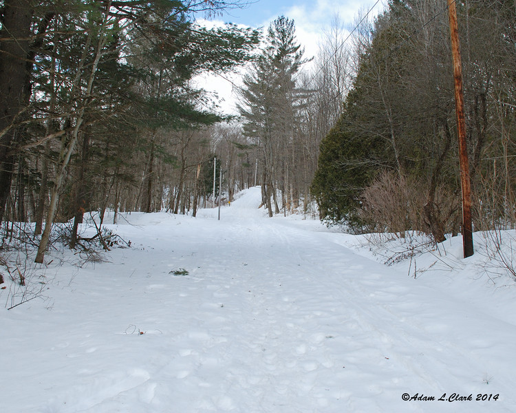 The road up to the summer trail head and parking is not plowed in winter.  The is an optional winter lot you use, you just have to walk a little further