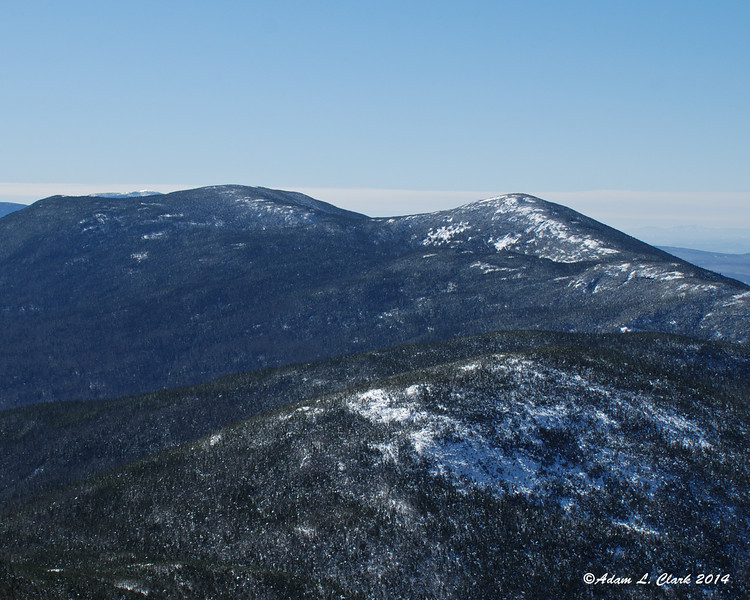Northeast Cannon Ball (lower right), North Kinsman (upper right), South Kinsman (upper left). Mt. Moosilauke just peaking up in the back over South Kinsman