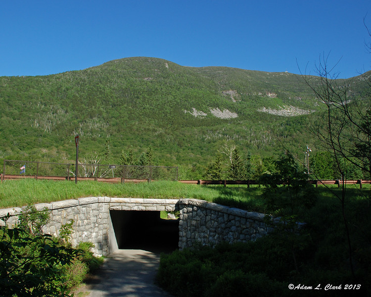 Getting ready to cross under the highway and start the hike.  The summit of Cannon Mountain can be seen on the right
