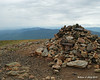 Looking west in a light rain at the summit cairn of Mt. Eisenhower