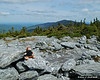 Miles taking a break on the summit of Mt. Abraham