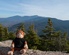 Miles on the summit of Mt. Avalon.  The Presidential Range is in view behind him