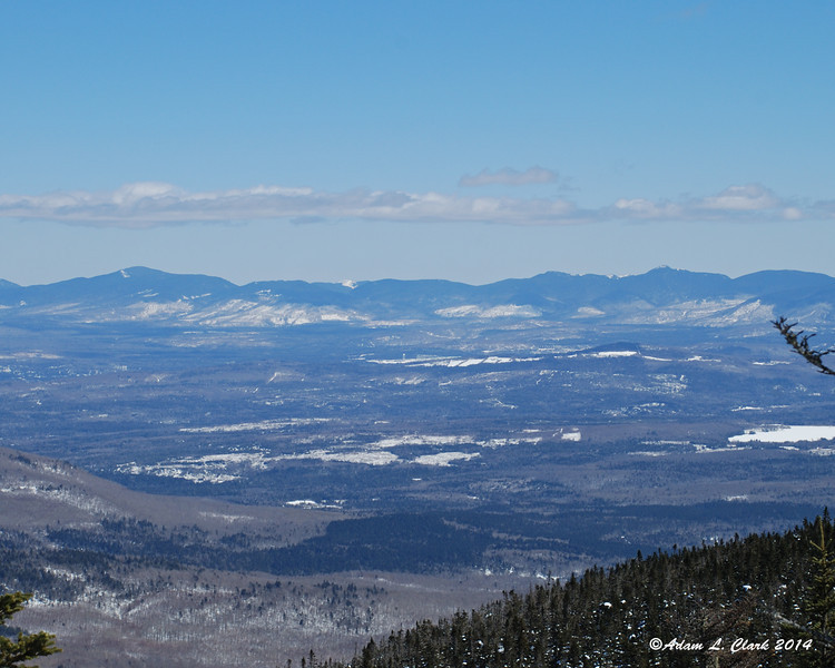 The Mahoosuc Range lies to the east and stretches into Maine