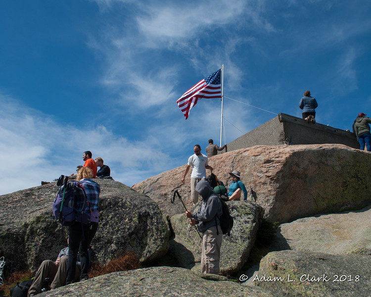 This side of the summit was in the sun and out of the wind making it a popular spot for hikers enjoying the summit