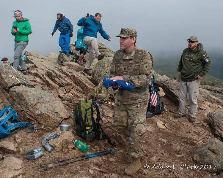 This years group had a few members of the Army.  Here one of them brings the flag to the pole