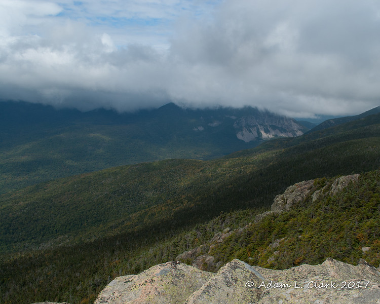 Looking into Franconia Notch with Cannon Mountain in the clouds up high