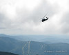 The NH National Guard helicopter flying past the summit