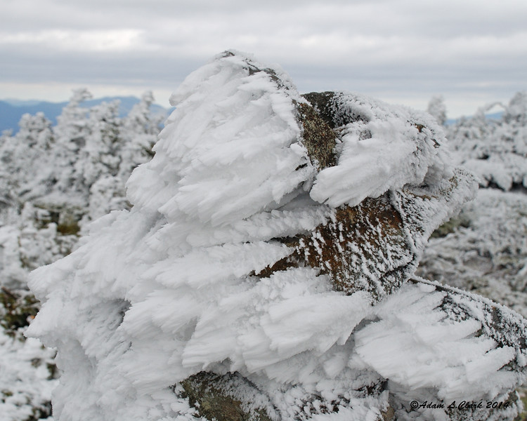 Rime has formed on the summit cairn at the South Peak