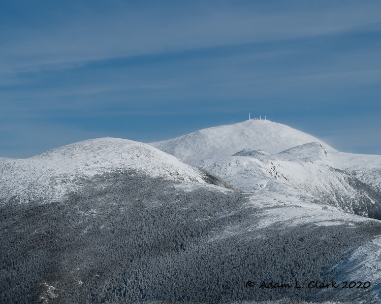 Mt. Eisenhower (the dome on the left), the next peak for the day.  Mt. Washington (with the towers) can be seen in the background with Mt. Monroe (triangle shaped peak) just in front of it