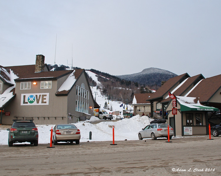 The summit of Mt. Tecumseh lies on the right behind the main lobby of Waterville Valley
