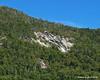 Some open rock along the steep hillsides around pond