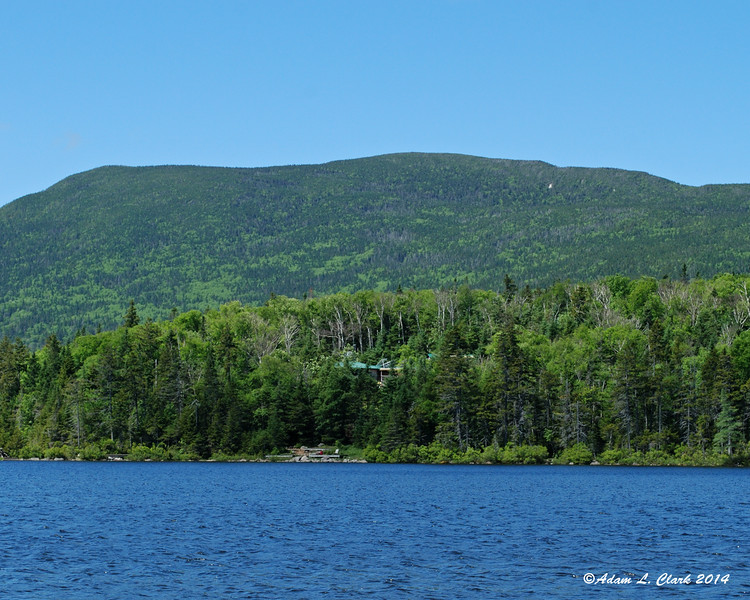 The AMC Lonesome Lake hut on the shore of the lake with South Kinsman behind