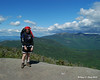 Jamie with Cannon Mountain and Franconia Ridge behind her