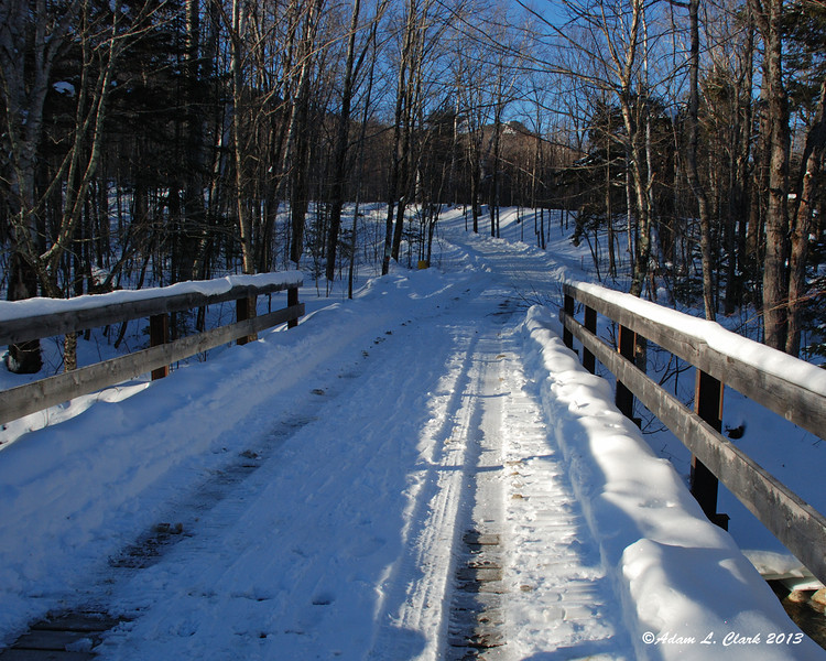 At the end of the Little River Rd, there is a bridge you cross to get to the path to the summer trail head.  The path is on the left immediately after the bridge
