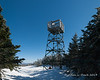 There is an old fire tower at the summit that you can climb up by ladder to have great views in all directions