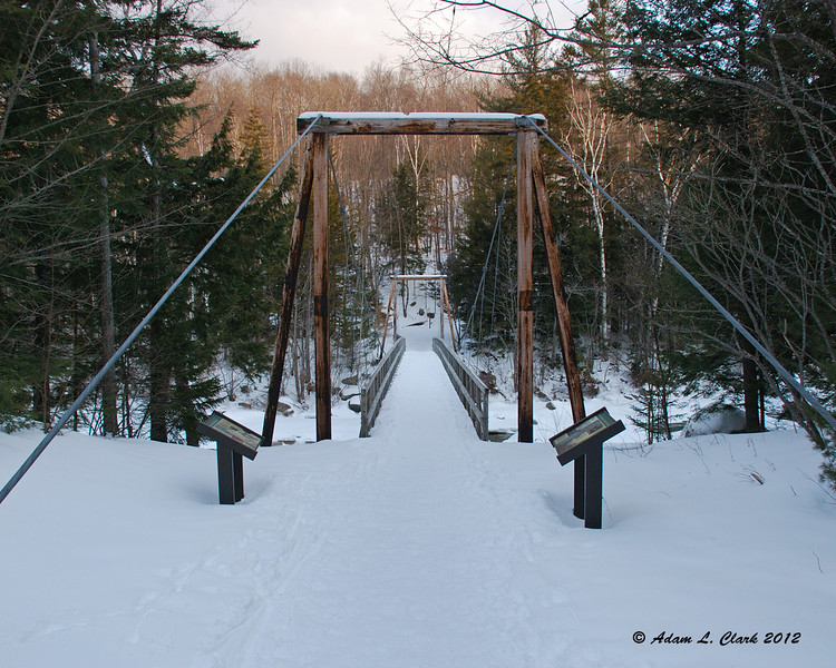 The suspension bridge at the start of the Lincoln Woods Trail crossing over the East Branch of the Pemigewasset River