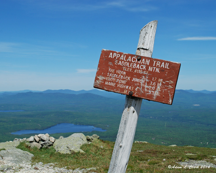 The summit sign on Saddleback Mountain.  Not sure why the sign says the elevation is 4 feet less than what the map says