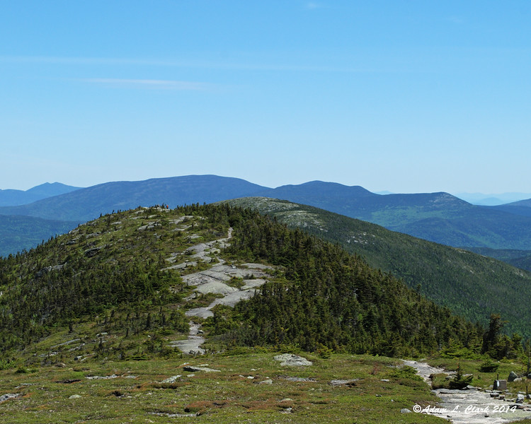 The trail heads over this shorter subpeak and then down into a saddle before coming back up Saddleback Mountain, The Horn which is just showing behind
