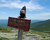 Miles hanging out on his second summit sign of the day.  The one is off by more than the last one claiming the summit is 18 feet shorter than the map says