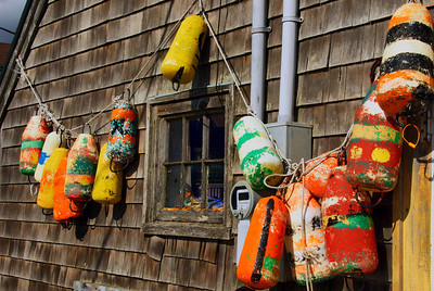 Lobster trap floats that were hanging on the dock-house wall in Peggy's Cove