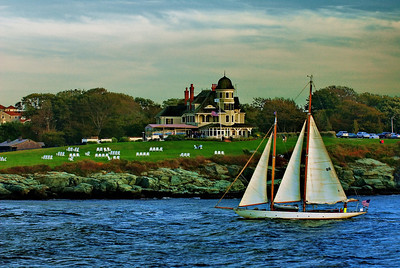 Newport, Rhode Island, typical seaside mansion with chairs for watching sunsets and sailboats.