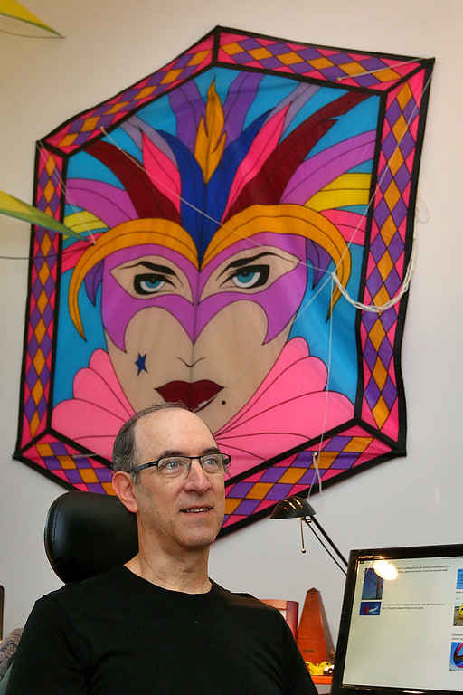 . New England Kite Artist Glenn Davison of Chelmsford has written a new book on kites and talk about it at his home on Wednesday morning. SUN/JOHN LOVE