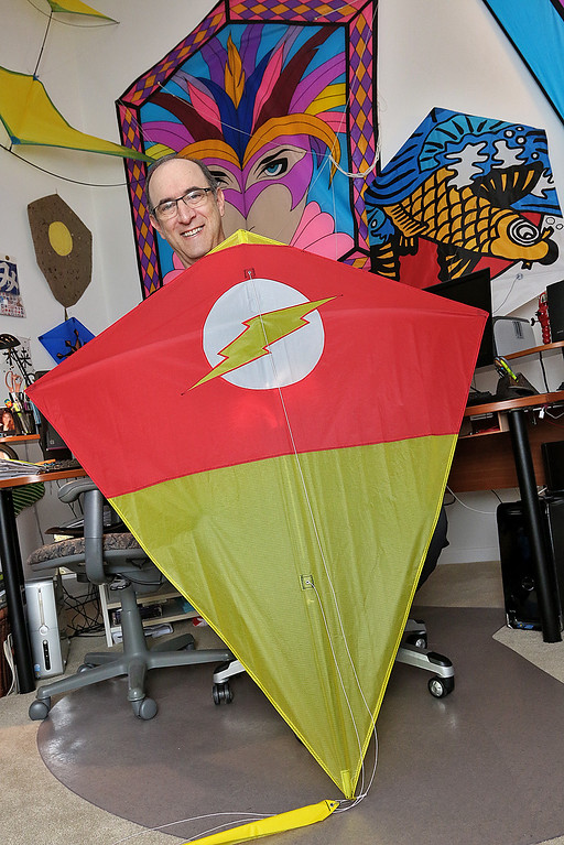 . New England Kite Artist Glenn Davison of Chelmsford has written a new book on kites. This kite with the DC Flash logo it was created by Davison. SUN/JOHN LOVE