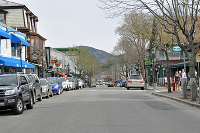 Main Street in Bar Harbor looking toward the hills and mountains in Acadia National Park.