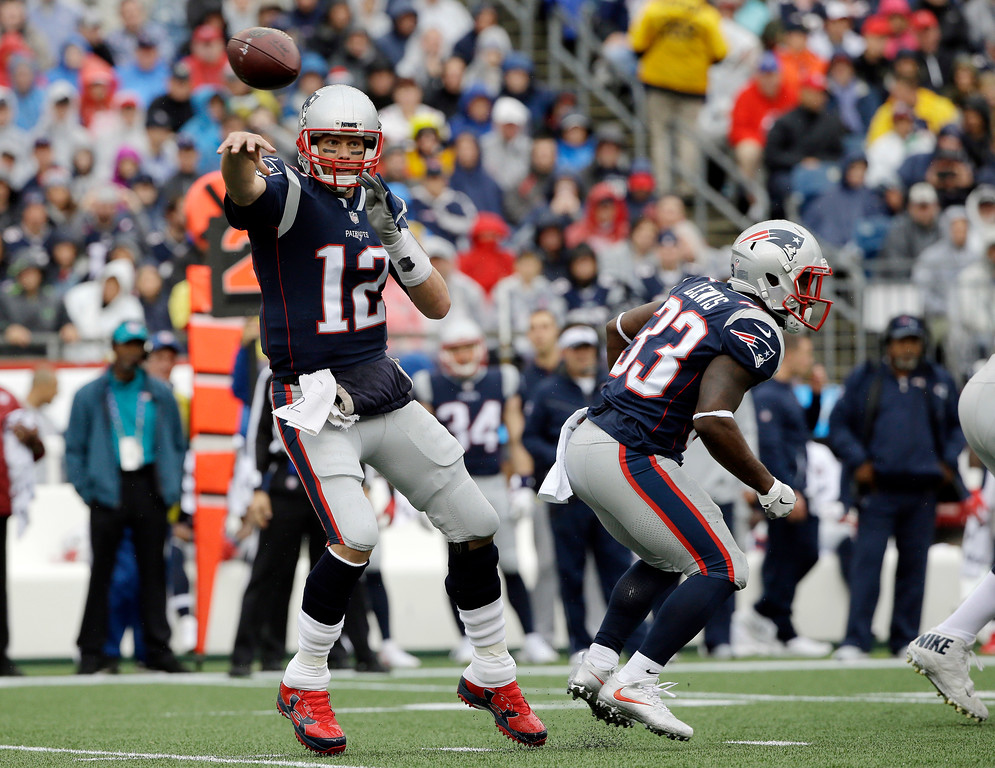 . New England Patriots quarterback Tom Brady passes against the Los Angeles Chargers during the first half of an NFL football game, Sunday, Oct. 29, 2017, in Foxborough, Mass. (AP Photo/Steven Senne)