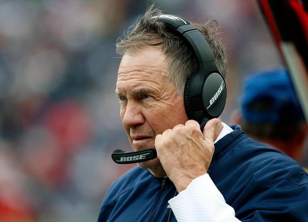 . New England Patriots head coach Bill Belichick watches from the sideline during the first half of an NFL football game against the Los Angeles Chargers, Sunday, Oct. 29, 2017, in Foxborough, Mass. (AP Photo/Michael Dwyer)