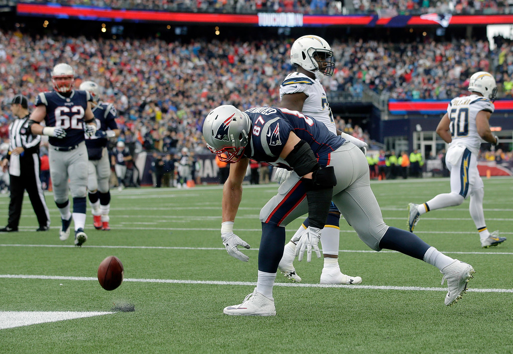 . New England Patriots tight end Rob Gronkowski spikes the ball after catching a touchdown pass against the Los Angeles Chargers during the first half of an NFL football game, Sunday, Oct. 29, 2017, in Foxborough, Mass. (AP Photo/Steven Senne)