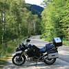 I tiny winding road through a mountain pass in Maine, and the GS1200.