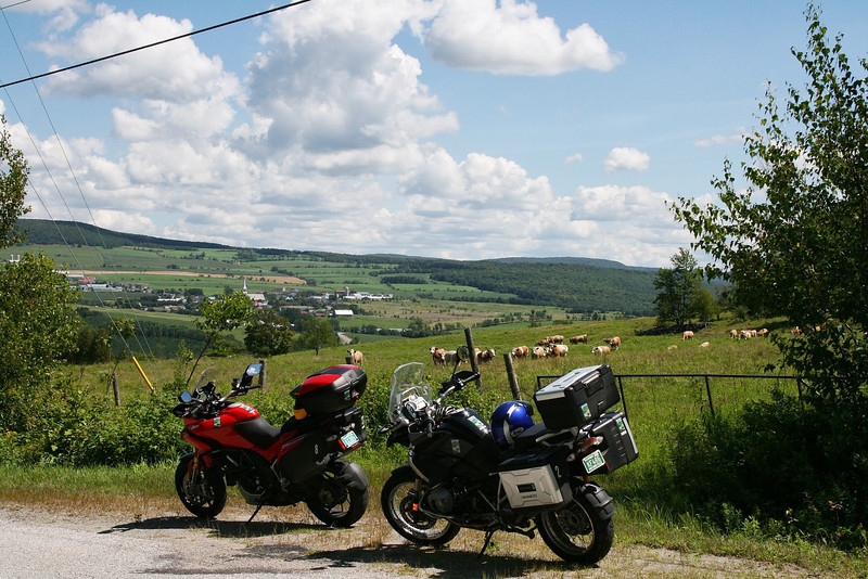 Enjoying a break by a pastoral southern Quebec ranch.