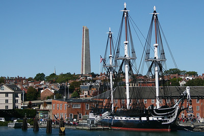 The USS Constitution located at the Charlestown Navy Yard.    http://www.ussconstitutionmuseum.org/ The Bunker Hill Monument is seen in the background - it is actually  located on Breed's Hill in Charlestown.  http://www.nps.gov/bost/historyculture/bhm.htm
