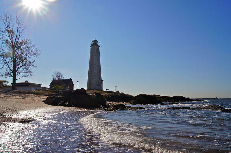 The New Haven Lighthouse at Lighthouse Point, located at the Eastern point of New Haven Harbor. Old Maps show it as Five Mile Point, called that because that is the distance between it and the center of New Haven. It was also called Morris Point during the Colonial period.