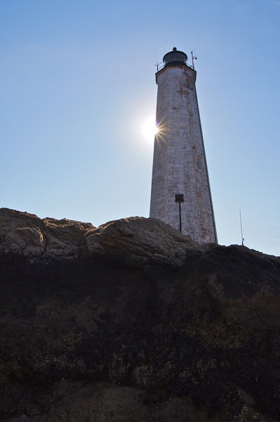 Sun flare behind The New Haven Lighthouse at Lighthouse Point.
