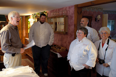 Everyone received a chef's coat! The owner of the inn is at the left.