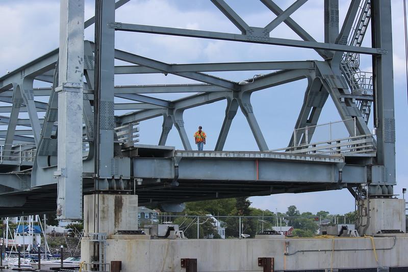 Worker on the Raised Long Bridge