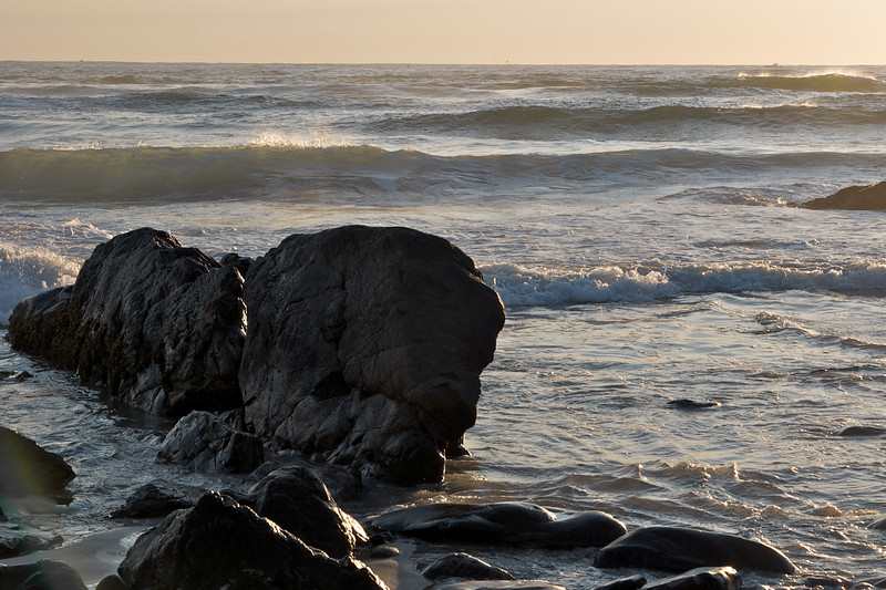 Rocks, beaking waves