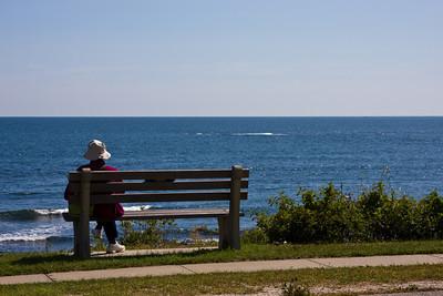 Woman on Bench Overlooking the Ocean
