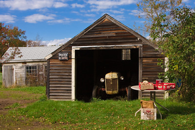 An Old Tractor in a Barn on a Rural Farm, West Newbury MA