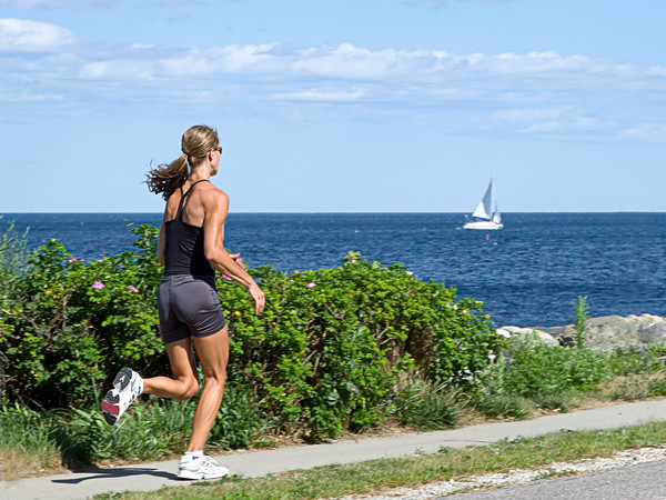 Woman Running near Ocean, North Hampton, NH