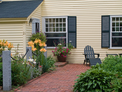 Traditional Brick Path and Flower Garden
