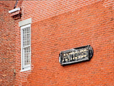Weathered Antiques Sign on a Restored Building, Newburyport MA