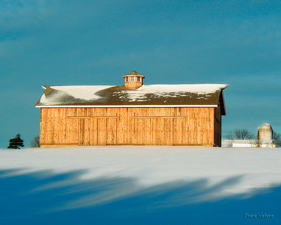 A Wood Barn on Top of a Snowy Hill, West Newbury MA