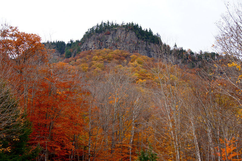 Frankenstein Cliff rises above the fall foliage; Crawford Notch State Park, White Mountains, New Hamphsire.