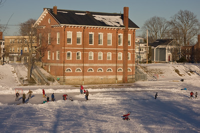 Children Playing Ice Hockey on a Frozen Frog Pond