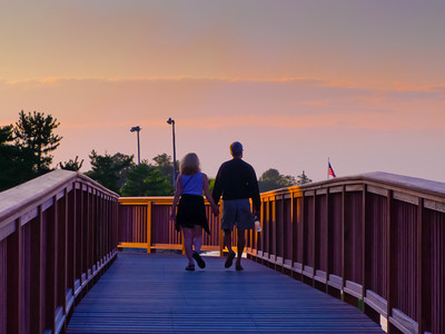 Couple Walk into Setting Sun along the Merrimack River
