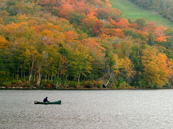 Canoeing on a Mountain Lake in Autumn